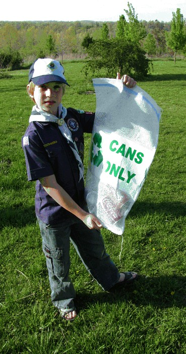 Cub Scout Eamonn Clark of Bergman Pack 179 models the new recycling bags